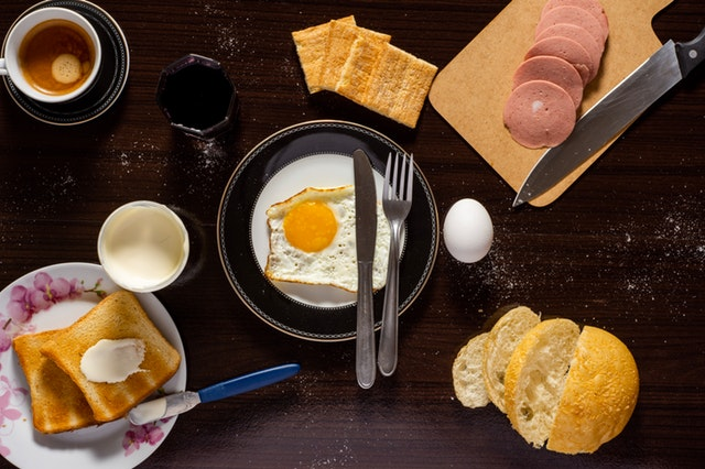 plate-of-sunny-side-up-sliced-meat-and-bread-1448722